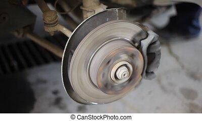 Automotive - Closeup video of car disc  brakes rotating