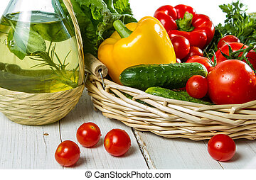 Fresh vegetables and a bottle of olive oil