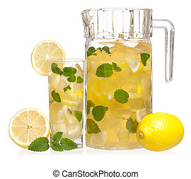 Glass of lemonade - Pitcher and glass of lemonade with mint...