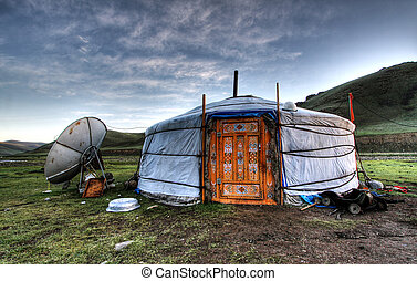 Mongolian dwelling on the green plain of grass