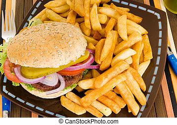 Hamburger and fries - Hamburger with salad, pickle, onions,...