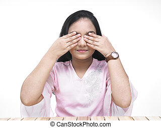 girl covering her eyes with palms