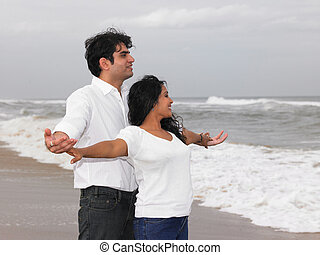 Asian couple standing by the sea - Asian couple standing at...