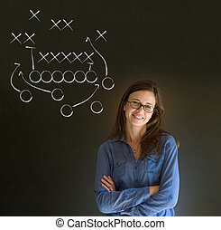 Woman with American football strategy on blackboard -...