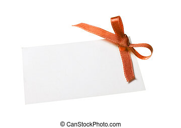 Blank gift tag tied with a bow of orange satin ribbon....