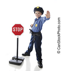 Stop - An adorable elementary boy gesturing to stop while in...