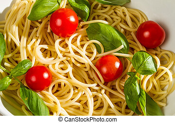Close-up of pasta with tomato and basil