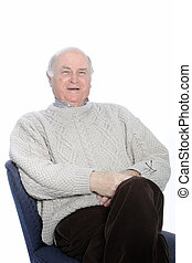 Happy senior man relaxing in a chair