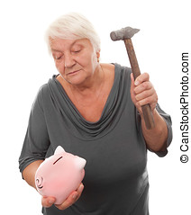 woman with piggy bank - senior woman breaking a piggy bank