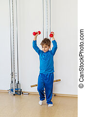 Child is therapeutic exercises in the gym
