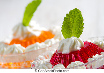Closeup of colorful jelly with mint leaf