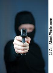 killer - men with handgun close up