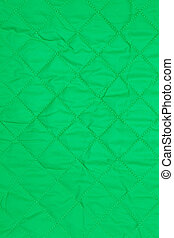 green quilted fabric, vertical background
