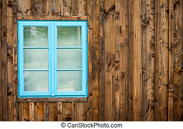 Old home with blue window background