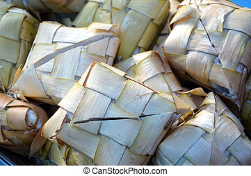 ketupat, Indonesian traditional food which is rice steamed...