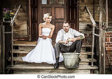 Young couple on the old porch is preparing dinner