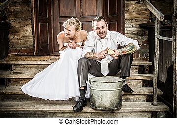 Happy young couple on the old porch