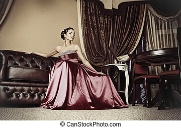 awaiting - Beautiful young woman in a luxurious classic...
