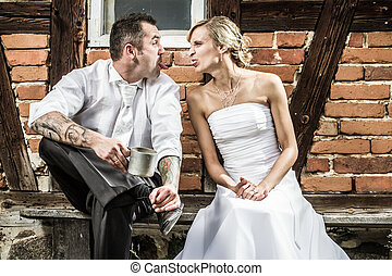 Young couple doing silly faces to each other