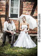 Young couple resting in front of vintage house