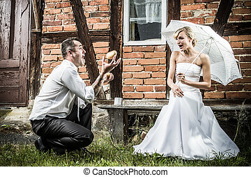 The groom shows off in front of a bride