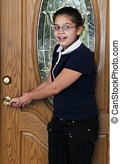 Preteen Checking the Door Lock - Preteen girl checking the...