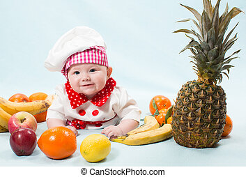 Portrait of smiling baby wearing a chef hat surrounded by...