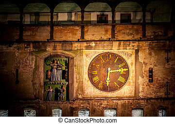 Old clock in Sighisoara medieval city, photo taken night...