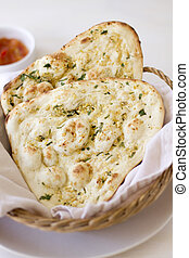 Garlic Naan Flatbread - Two pieces of herbed garlic naan...