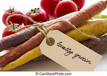 Organic Vegetables - Organic rainbow carrots and tomatoes...