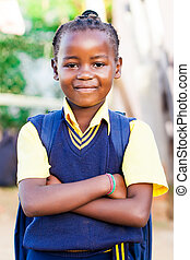 time for school - an young african girl in her blue and...
