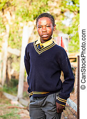 early bird - an teenage african boy readily dressed in his...