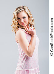 naughty girl - a pretty teenage blond caucasian girl in a...