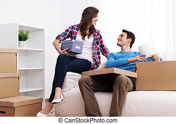 Loving couple unpacking in their new home