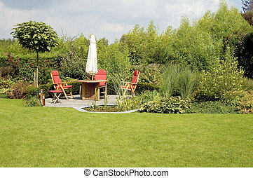 dining table with chairs and parasol in a lush garden