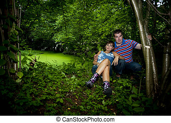 Happy couple - Happy pregnant couple is relaxing in nature