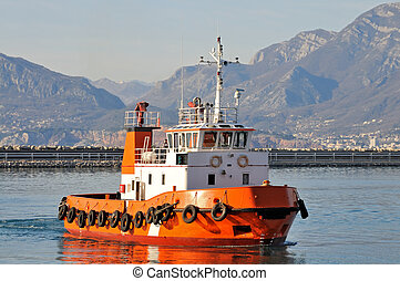 Orange tugboat - Tugboat in the harbor on standby