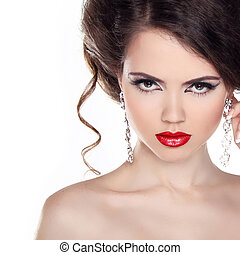 Red lips. Beautiful woman with curly hair and evening make-up. Jewelry and Beauty.