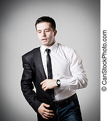 Handsome young businessman wearing suit