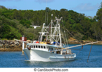 A fishing trawler - A medium sized trawler heads out to do...