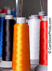 different color spools of threads