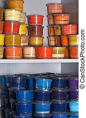 Paint can color palette on shelves