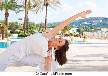 Senior woman doing yoga - Middle aged woman doing warrior...