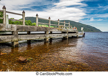 Old harbor over Loch Ness in Scotland