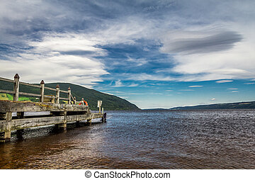Old harbor over Loch Ness in sunny Scotland