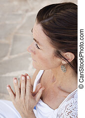 Meditating woman - A senior lady doing yoga, holding her...