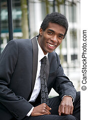 Handsome young african american businessman smiling -...