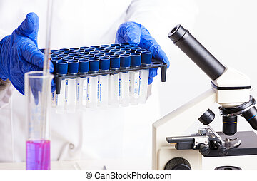 Laboratory equipment - Lab technician holding test tubes...