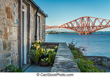 House close to the Firth of Forth Bridge in summer