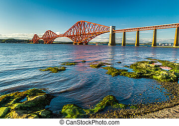 Small bay near Firth of Forth Bridge in Scotland